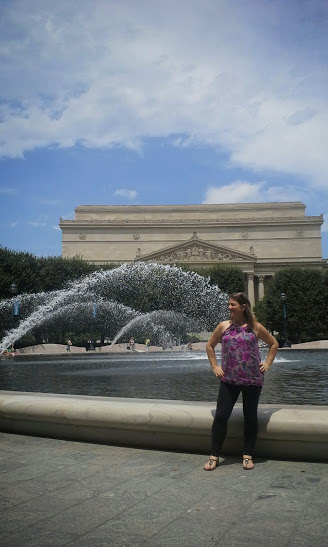 Me by the reflecting pool / water fountain. In the background is the National Archives Museum