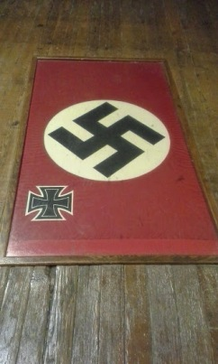 Nazi flag, conveniently placed on floor so everyone can step on it.
